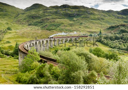 Glenfinnan Viaduct with steam train / The famous Glenfinnan Viaduct which carries the steam train from Fort William to Mallaig - stock photo