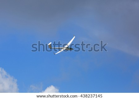 Glider flying in the summer sky.