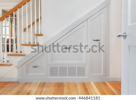 Gliding under stair pullout cabinets for kitchen small appliance storage - stock photo