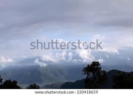 Glimpse of Snow covered Annapurna range - stock photo