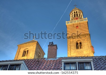 Glistening church towers in the late afternoon light, Utrecht. - stock photo
