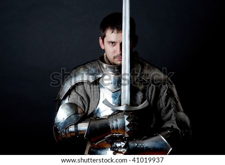 Glistening Knight holding two-handed sword - stock photo