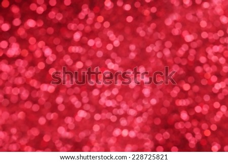 Glitter red Christmas background, abstract with defocused lights. - stock photo
