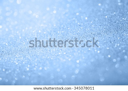 glitter sparkles dust on background, shallow DOF - stock photo