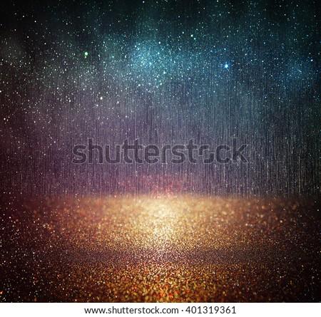 glitter vintage lights background. blue, gold and black. defocused.  - stock photo