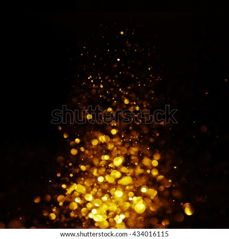 glitter vintage lights background. dark gold and black. defocused. Christmas card