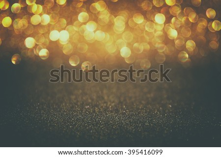 glitter vintage lights background. gold and black. defocused.  - stock photo