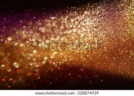 glitter vintage lights background. gold, silver, purple and black. de-focused.  - stock photo
