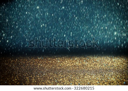 glitter vintage lights background. light silver, blue  gold and black. defocused. abstract  - stock photo