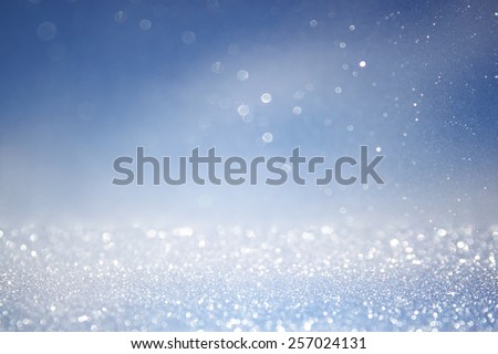 glitter vintage lights background with light burst . silver, blue and white. de-focused.  - stock photo