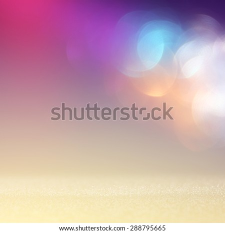 glitter vintage lights background with light burst . silver, blue, gold and white. de-focused.  - stock photo