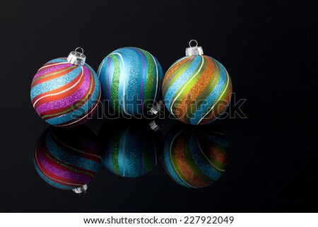 Glittered multi-colored Christmas ornaments - stock photo