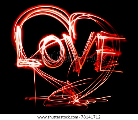 Glittering, glossy, heart, painted light, on a black background. - stock photo