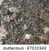 Glittering precambrian rock - pattern / background - stock photo