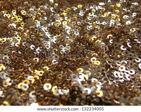 Glittering sequins in black and golden yellow. More of this motif and more textiles in my port. - stock photo
