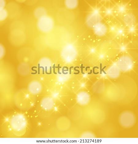 Glittering stars on golden glittering Christmas background - stock photo