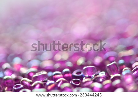 glitters and sparkles blur and bokeh background / colorful beads / fashionable accessories - stock photo