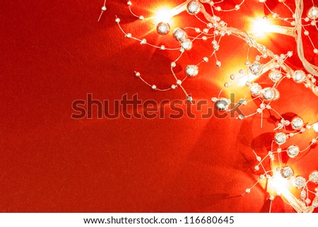 Glittery Christmas lights with decorations - stock photo