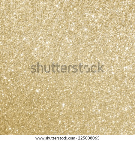 Glittery gold background texture perfect for Luxury, fashion or Christmas and holiday season designs. - stock photo