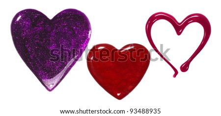 Glittery nail polish puddles in shape of hearts isolated on white - stock photo