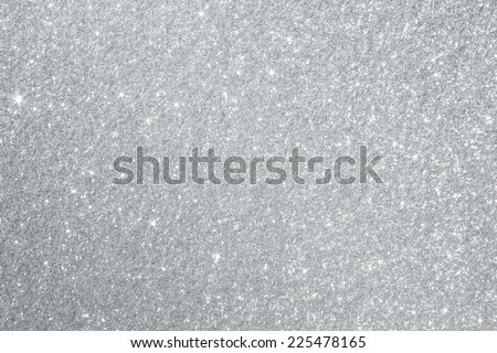 Glittery silver background texture perfect for Luxury, fashion or Christmas and holiday season designs. - stock photo