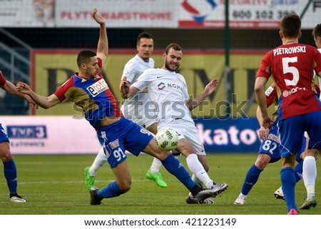 GLIWICE, POLAND - MAY 15, 2016: Match Polish Premer League between KGHM Zaglebie Lubin - Piast Gliwice. In action Hebert Silva Santos (L) and Filip Starzynski (R).