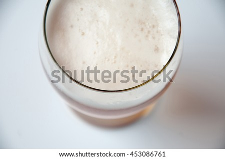 Gllass of light beer isolated on a white background