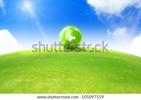 global and green grass with blue sky - stock photo