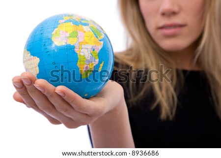 global business concept with a globe and businesswoman