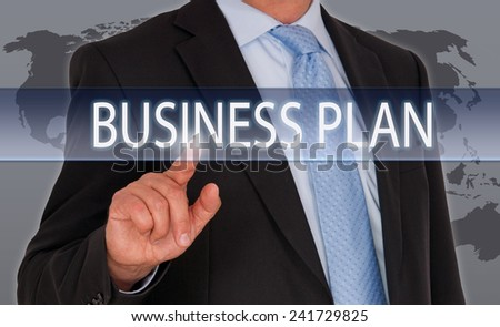 Global Business Plan - Businessman with touchscreen and world map in the background - stock photo