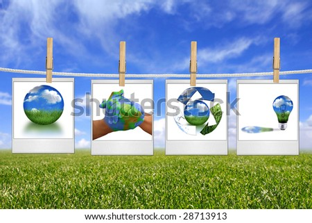 Global Concept of Green Energy Solutions Hanging on a Rope Inside Film Blanks - stock photo