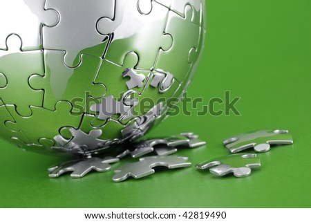 Global environment solution concept - earth jigsaw puzzle - stock photo