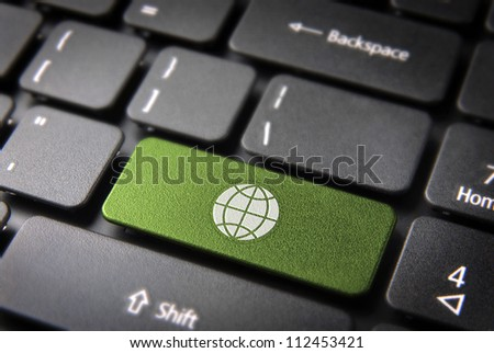 Global go green key with Earth icon on laptop keyboard. Included clipping path, so you can easily edit it. - stock photo