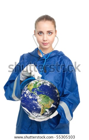 Global health problems - doctor holding a globe and listen it with sthetoscope