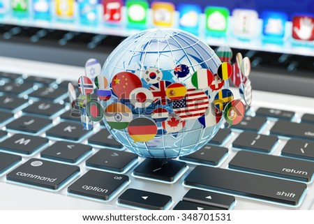 Global internet communication, online messaging and translation concept, speech bubbles with national flags of world countries around blue Earth globe on computer laptop keyboard (Elements by NASA) - stock photo