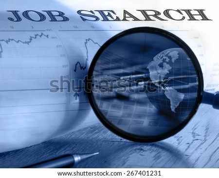 "Global job search. Magnifying glass over a newspaper classified section with ""Job search"" text - stock photo"
