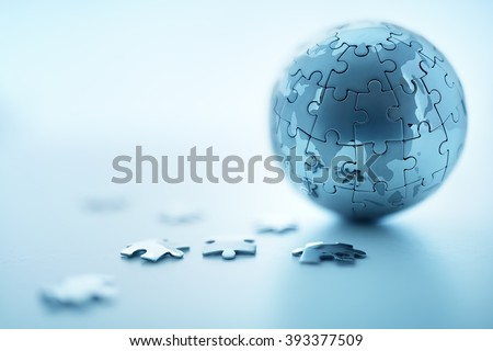 Global strategy solution concept - earth jigsaw puzzle - stock photo