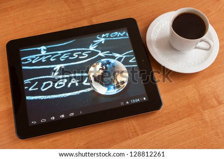 Global success on digital tablet on the table. - stock photo