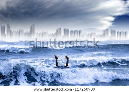 global warming and extreme weather concept. man drowning in the water and storm destroyed the city - stock photo