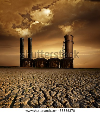 Global Warming and pollution theme with chimneys;gas and dry land - stock photo