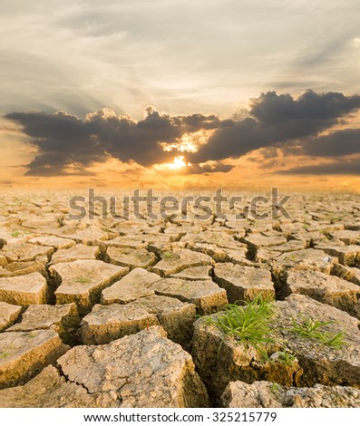 Global warming concept. drought land under the evening sunset - stock photo