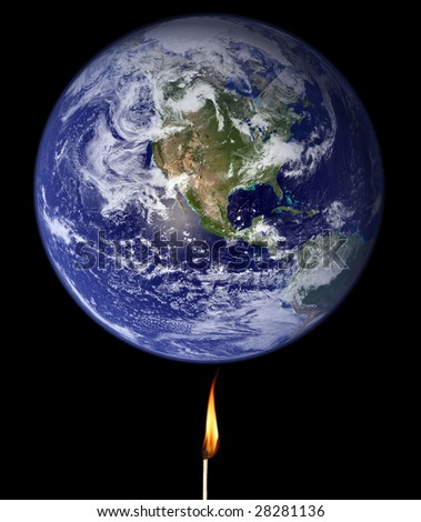 Global warming concept: match stick burning the Earth (Nasa imagery). - stock photo