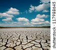 global warming. dramatic sky over cracked earth - stock photo
