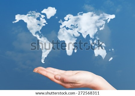 Global. World map cloud shape floating on hand - stock photo