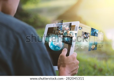 Globalization business concept.Businessman using digital tablet. - stock photo