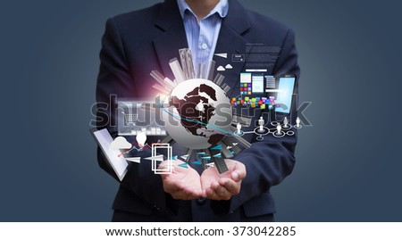 Globalization. Businessman hold the World and Technology. Globalization and Technology. Human and technology. Technology and Communications.