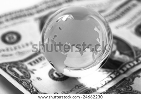 Globe and american dollars on white background. - stock photo