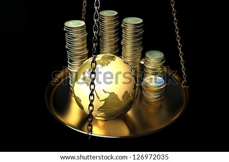 Globe and coins on scales. - stock photo
