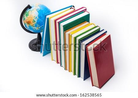 globe and colorful books isolated on white - stock photo