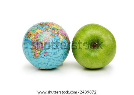 Globe and green apples isolated on white - stock photo